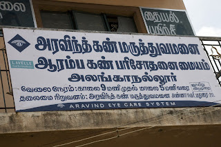 sign outside rural clinic in english and Tamil