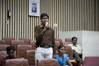 blind student speaking at seminar with microphone