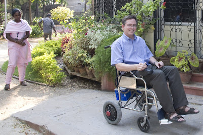 Jim Fruchterman in a powered wheelchair