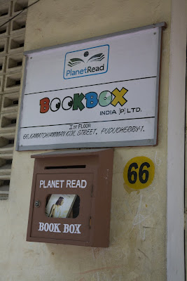Door signs for Planet Read and Boobbox