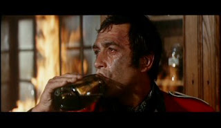 One of the most beautiful, grim and defiant swigs in film history