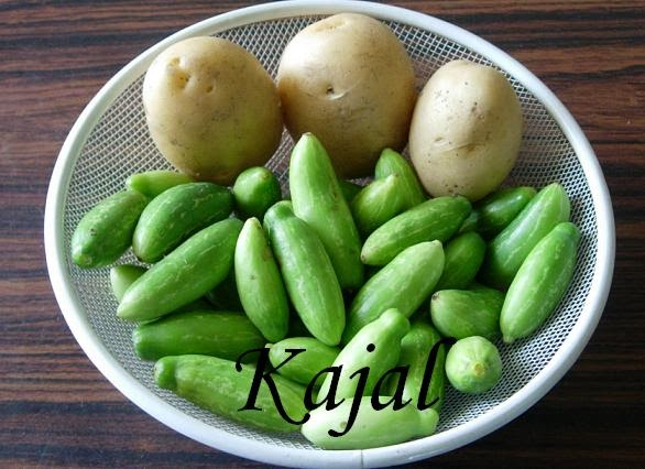 ... Step by Step Pictures...: Tindora-batata nu saak (Tenli with potato