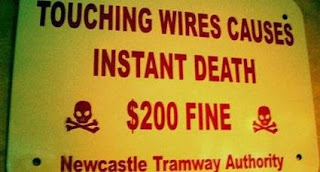touching wires causes instant death, sign