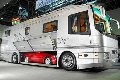 photo of an RV with a mercedes inside it