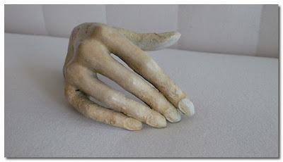 cast bronze hand at trove