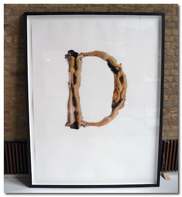 letter d made up from human bodies