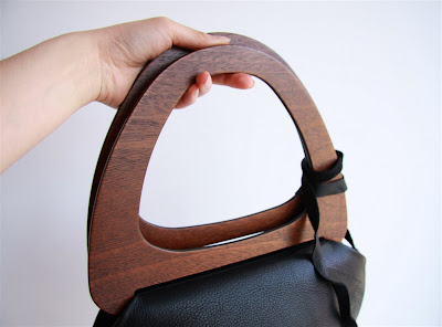 e7e3cb5f25b56 Wood Handled Bag by Tannis Hegan. Available in Black ...