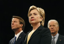 Hillary Clinton stands with John Edwards and Joe Biden