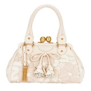 Lockheart Handbags and accessories are the result of the collective  passions and talents of designers Trang Huynh and Jennifer Tash. e0f18f5888981