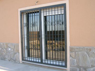 Herreria tapatia puertas ventanas y rejas metalicas en for Modelos de puertas metalicas