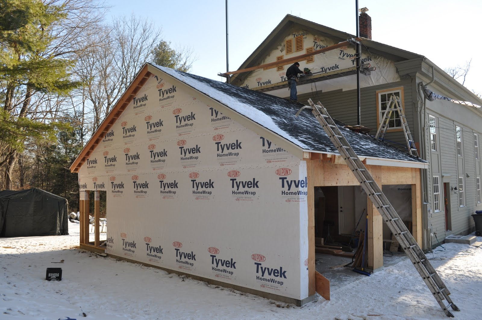 Work Is Continuing On The Garage Plywood All Outside Of And Covered With Tyvek You Can See Tony Adding Siding That My Wife