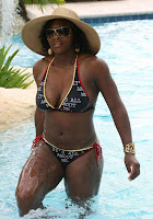 Serena walks out of the pool and shows her body off in bikinis