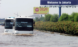 Airport Buses on Flooded Airport Toll Road