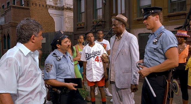 That's Miguel Sandoval from Repo Man and Medium as one of the NYPD patrolmen. The fact that not all the adversarial cops in Bed-Stuy were white was another nice touch in Do the Right Thing.