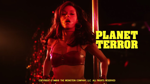 You're probably wondering why I'm posting the Planet Terror main title shot of Rose McGowan up against the stripper pole instead of the 'You might feel a little prick' advance poster with Marley Shelton. It's because Shelton, with her smeared mascara and a hypodermic needle in hand, looks too heroin chic-y on the poster. Heroin chic: never attractive.