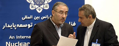 Hossein Mousavian whispering into the ear of Amir Zamaniniya - photo picked up from The Elephant Bar blogspot