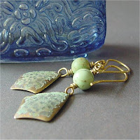 handmade earrings with turquoise balls and verdigris patina over vintage jewelry stampings