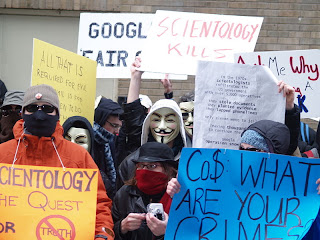Anonymous protesting against CoS