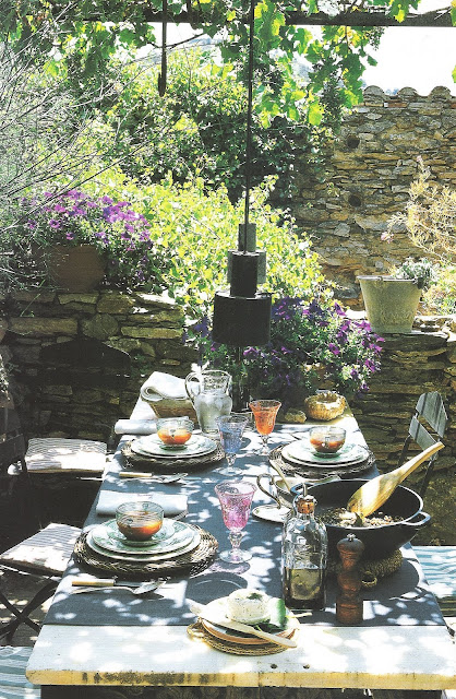 Côté Sud - stacked stone wall, stone top table, edited by lb for  linenandlavender.net, here:  http://www.linenandlavender.net/2009/08/and-livin-is-easy.html