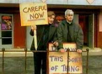 Father Ted, protesting