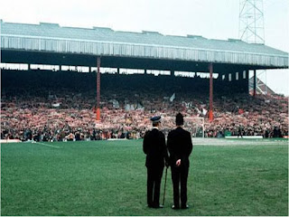 Police watch over the Stretford End