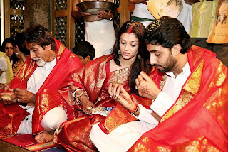 Aishwarya Rai With Abhishek And Amitabh Bachchan During A Pooja