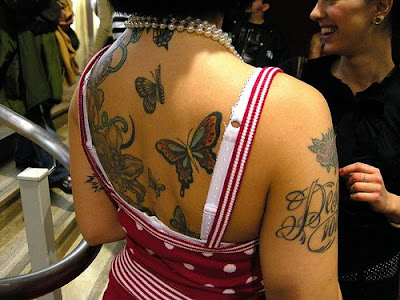 sexy girl with butterfly tattoo