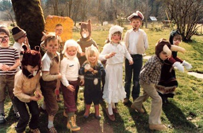 Autumn is in the sheep costume and white dress, to the right.
