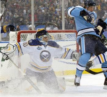 Winter Classic: Sidney Crosby, right, screens Buffalo Sabres goalie Ryan Miller, left, prior to Pens' Colby Armstrong's goal