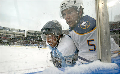 Sabres defenseman Toni Lydman (5) and Pen's Sidney Crosby