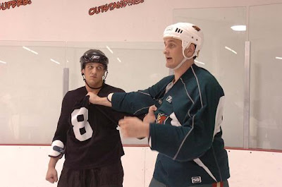 Aaron (black jersey), left and Derek (green jersey) Boogaard, right at hockey fight camp