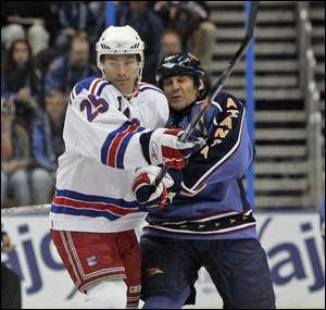 Petr Prucha, left, and the Rangers held off Scott Mellanby and the Thrashers