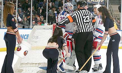 Lundqvist talks with the referee after he refused to let the ice girls clean the goal crease