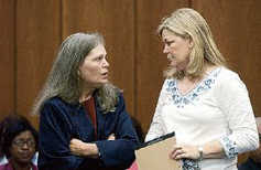 attorney, Betty Tenn Lawrence, left, with client Beth Brewer,at June 28th hearing