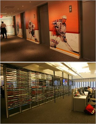 picture of Wayne Gretzky Wall at new NHL headquarters, wall of 470 hockey sticks (bottom)