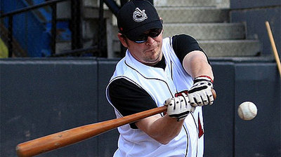 Theo Fleury takes batting practice with Calgary Vipers