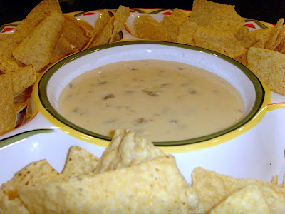Queso Blanco Dip on a serving platter with chips around it