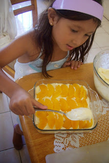 Sharkteeth covering the peach layer with the cream and milk mixture