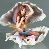 mermaid in a shell figurine