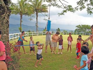Erica Ridley in Costa Rica: hitting a piñata
