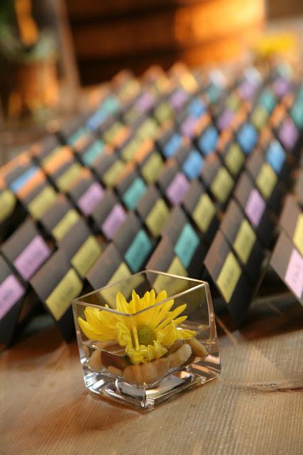 Flower and placecards at Hinterland Erie Street Gastropub wedding reception