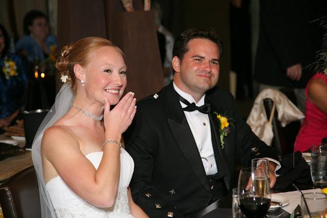 Bride laughing during toast at Hinterland Erie Street Gastropub wedding reception