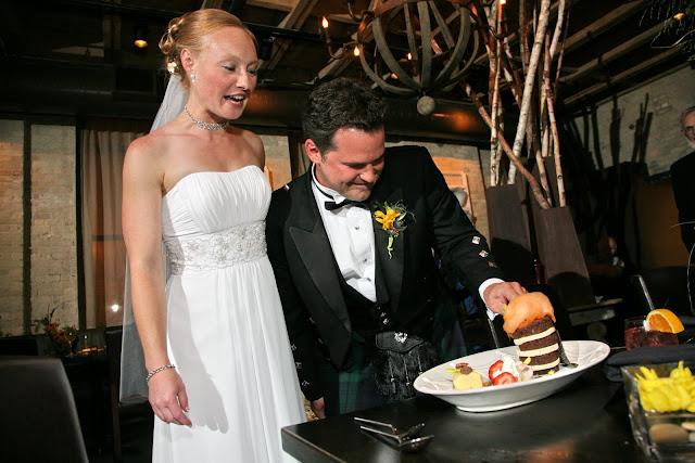 Groom cutting amazing Hinterland Erie Street Gastropub dessert as bride watches