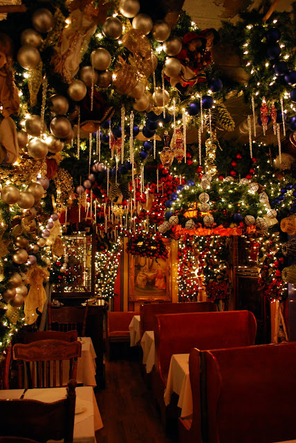 decorations are in every nook and cranny of the restaurant hanging overhead dripping from the ceilings walls and light fixtures like a fairytale
