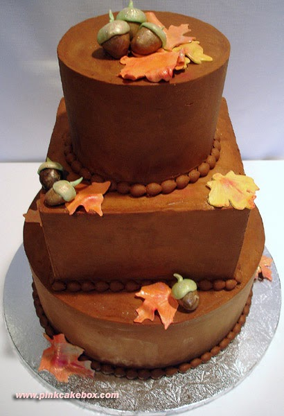 Tier Wedding Cake With Leaves Around It