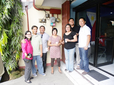Officers of WSC Cagayan de Oro pose with guests outside the store