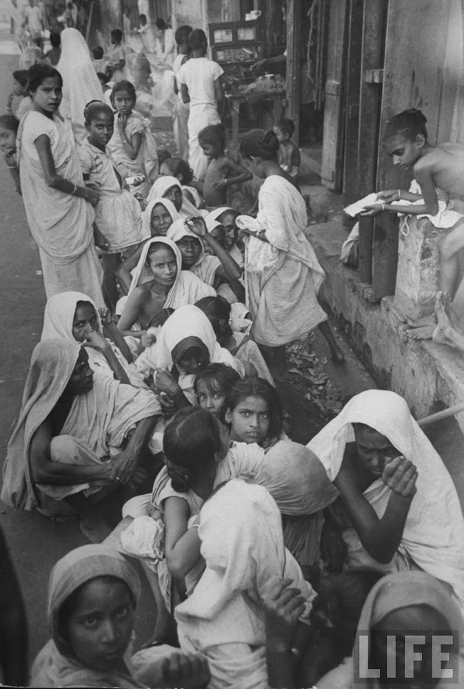 Starving women waiting for the government controlled Grain Shop to open