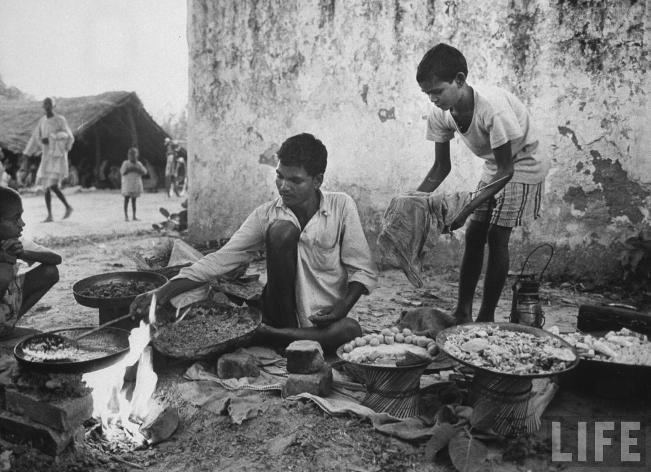 Indian vendor at his food stall at temple outside of village of Gaonkhera - 1962