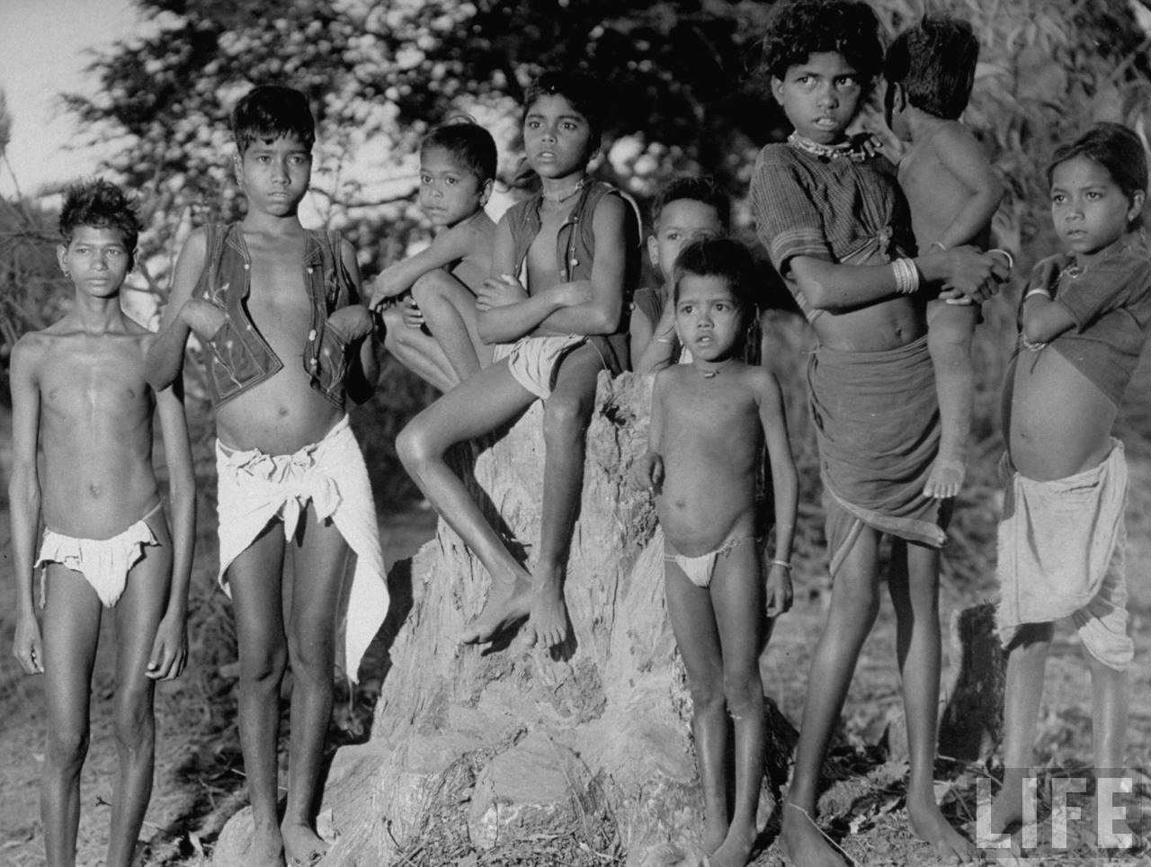 Indian aborigines children, posing near home in their village - 1946