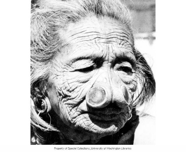 109 year old Apatani woman with nose plugs, Subansiri Frontier District - Arunachal Pradesh - India, ca. 1954